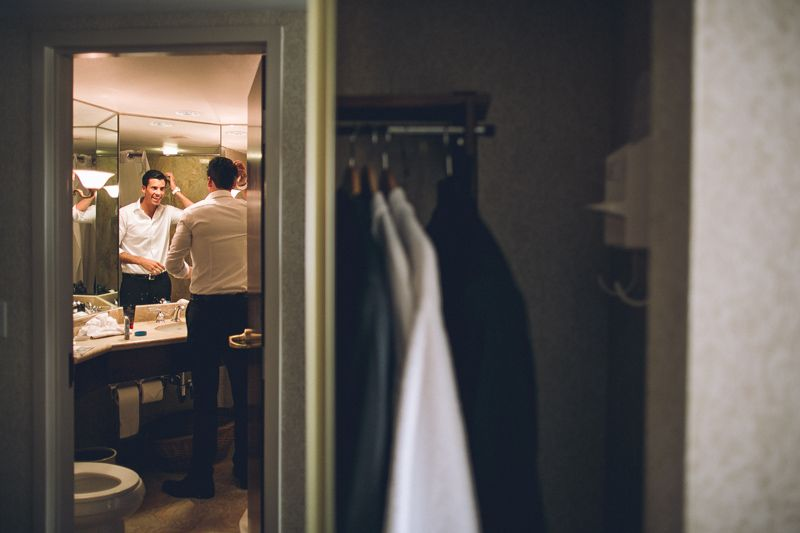 LDS groom getting ready before wedding