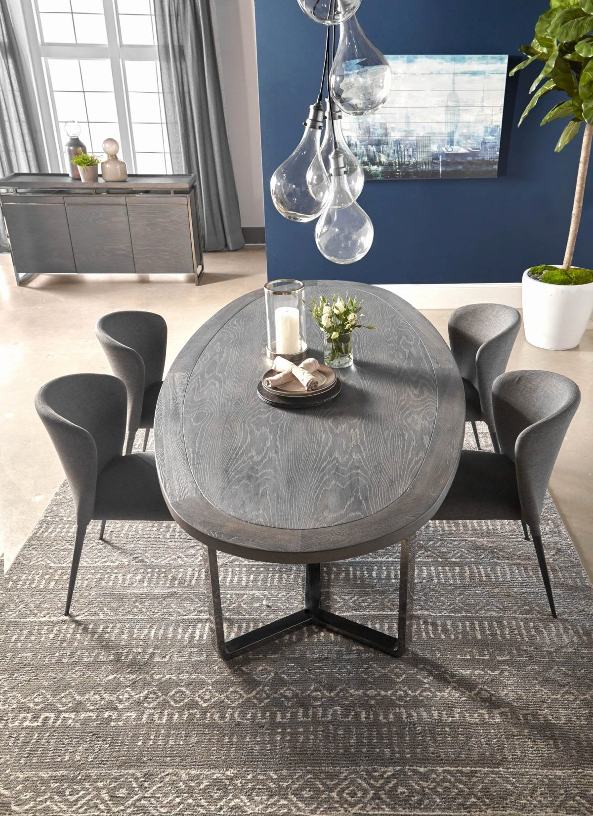 Magnificent Gray Oval Dining Table With Gray Chair And Nifty Lamp
