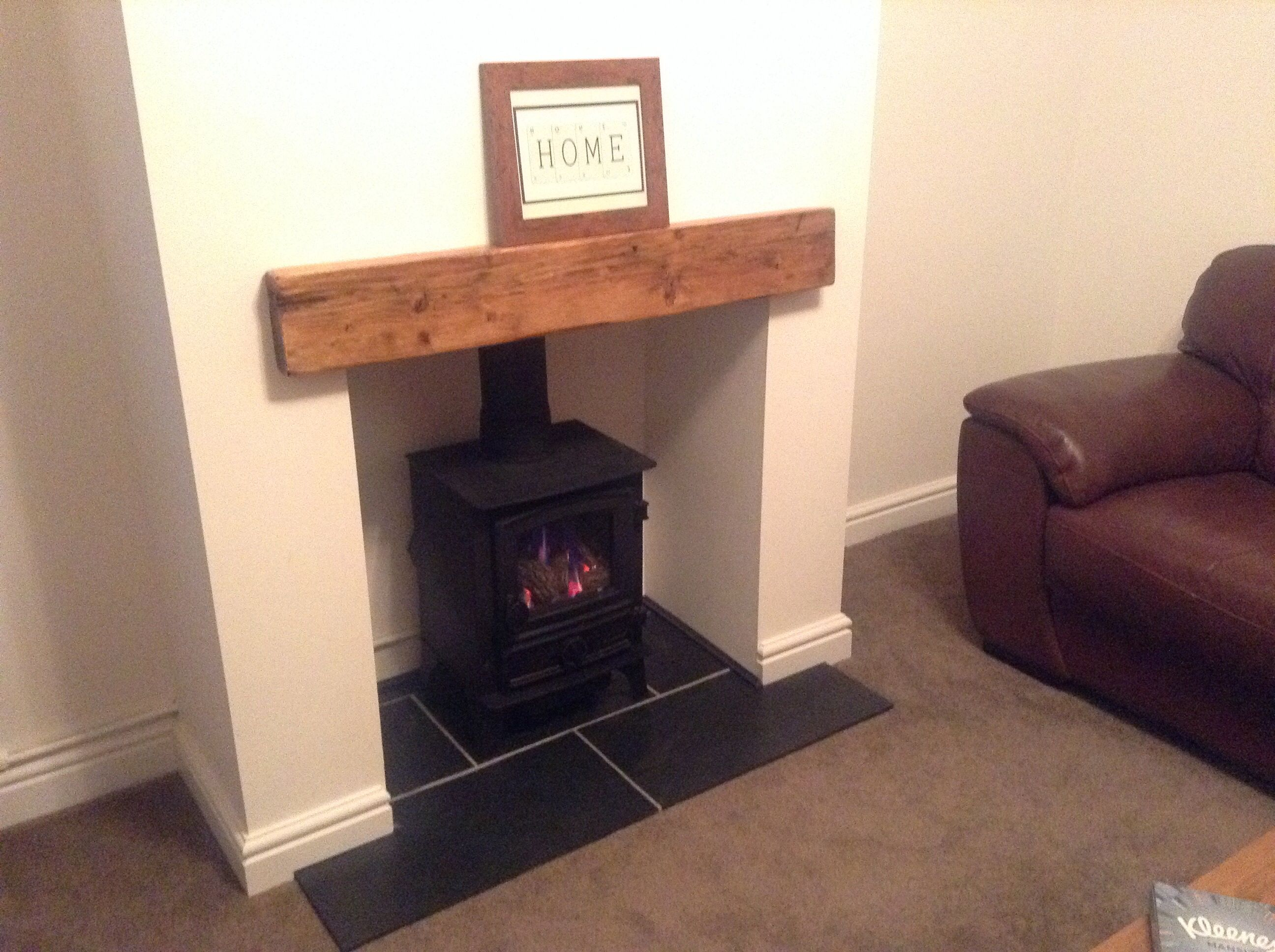 Gas effect log burner with slate hearth oak lintel