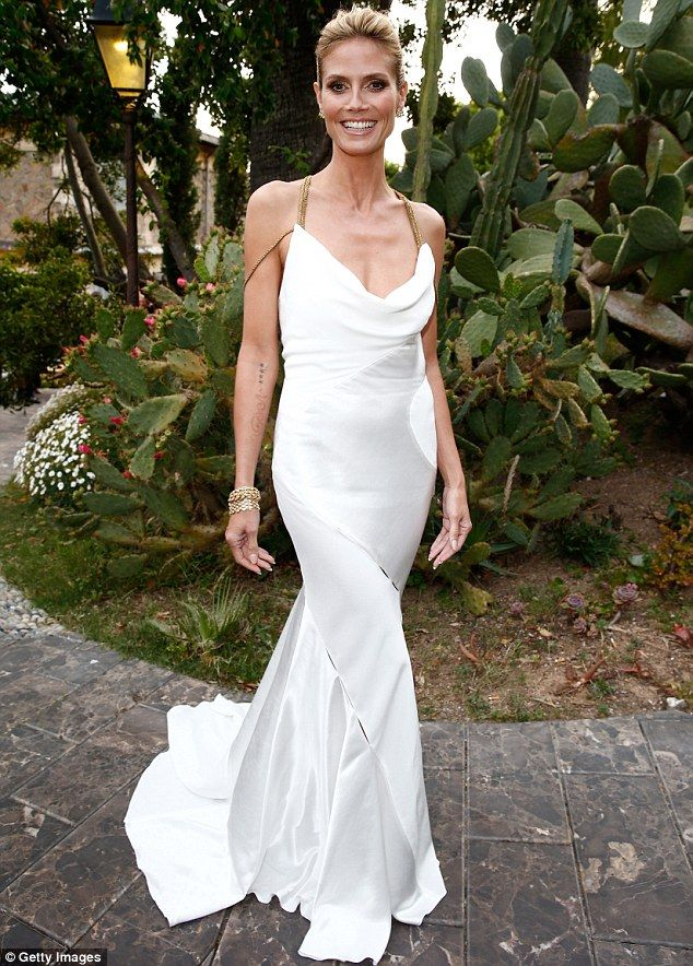 Heidi Klum Attracts The Light In Silky White Gown At Cannes Event