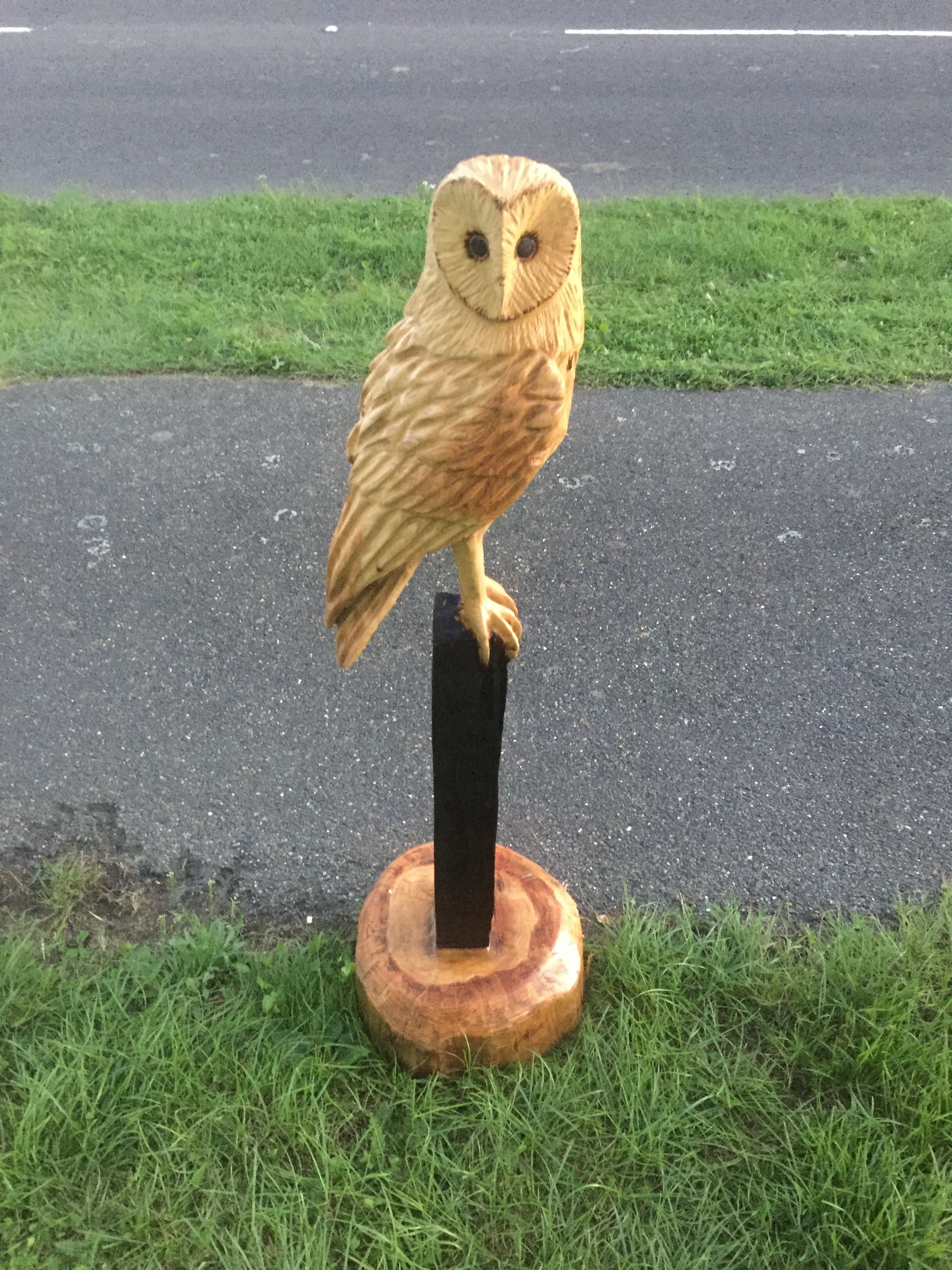 Chainsaw carved owl on post sculpture whittling wood wood