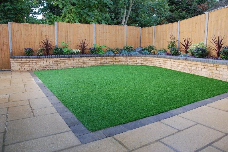Artificial grass laid in square back garden for Back garden patio ideas