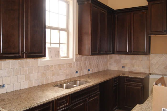 Kitchen Backsplash Neutral venetian gold granite, dark cabinets, and neutral backsplash