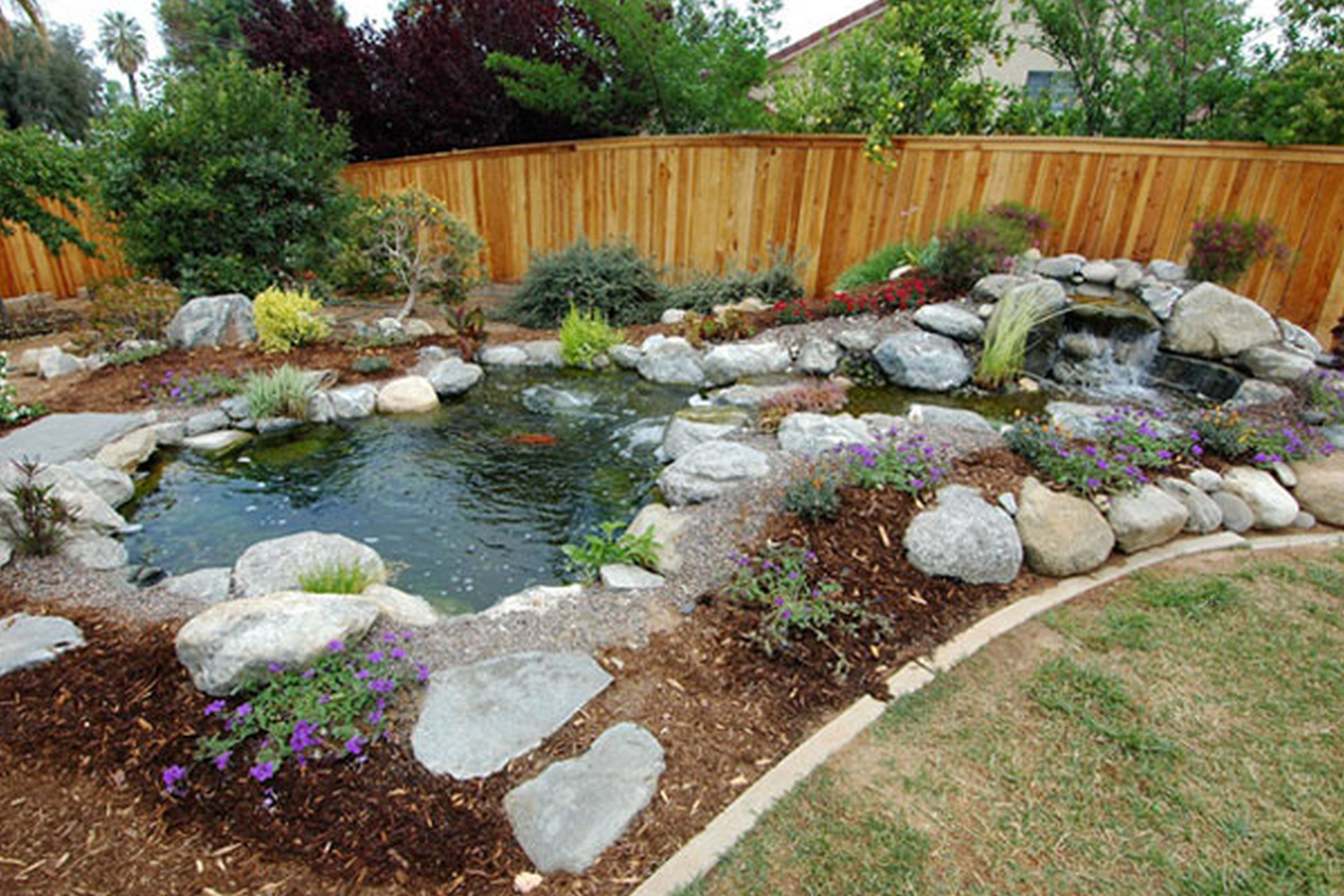 Backyard fire pit ideas landscaping backyard for Backyard fish pond designs