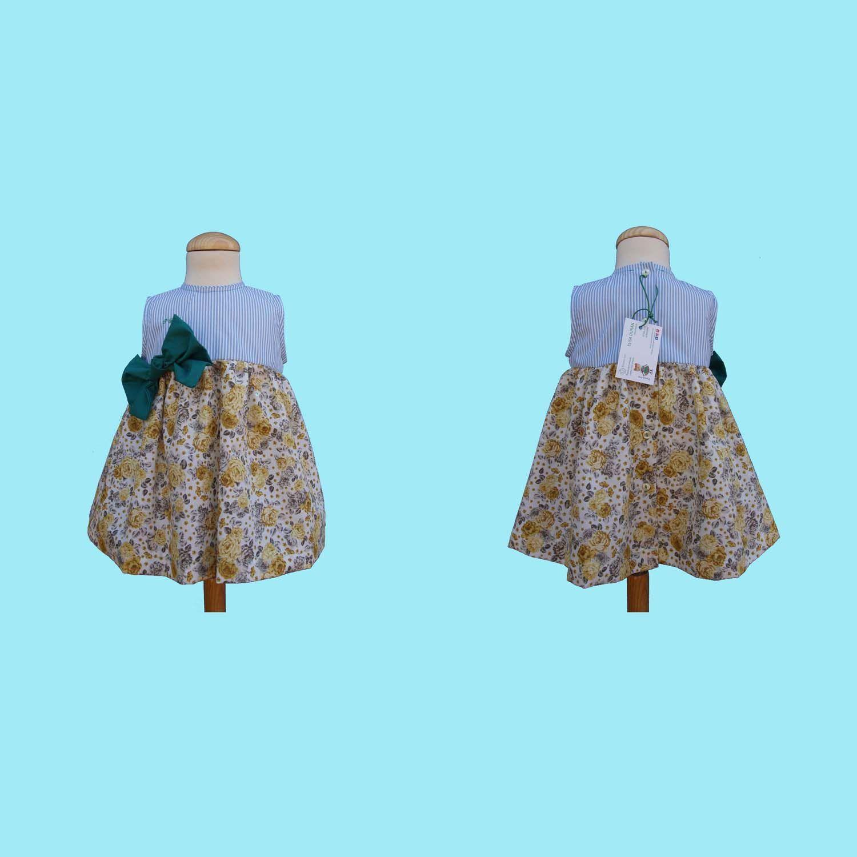 Confeccionado con dos telas diferentes, para el vestido con vuelo he ...