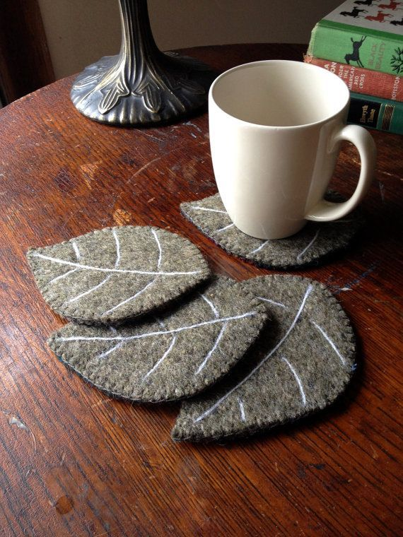 These 4 sheet coasters feature double, single sided and reclaimed wool felt pullovers. The veins are needle felt with white wool yarn. They are a sage / dusty green color and the back … – Pin Coffee