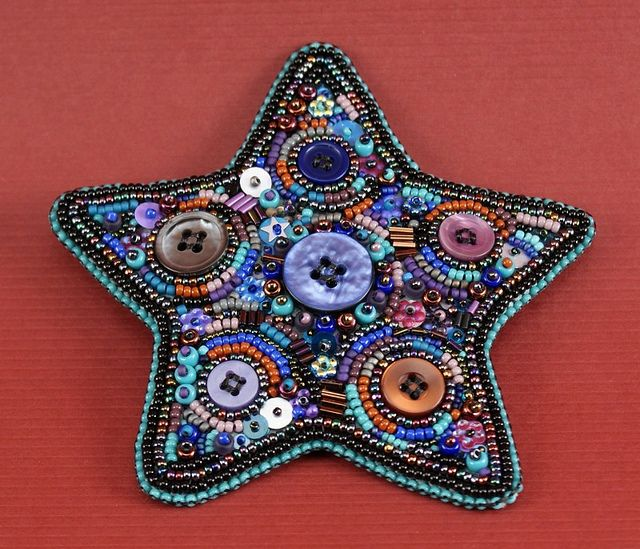 Bead embroidered star with buttons, sequins, seed beads.