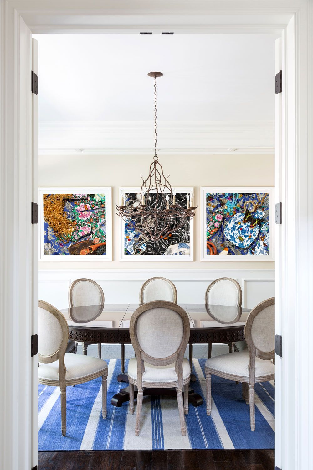 Beautiful dining room in the Hamptons. Bold artwork and blue striped ...