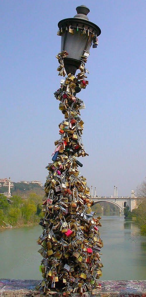 Pad locks of love in Italy.  Legend has it that if you and your loved one attach a padlock to any surface of the famous bridge and then throw away the key into the Arno River below, your love will last forever. Millions of couples have come to the Ponte Vecchio for expressly this reason, to lock in their love and throw away the key for eternity.....