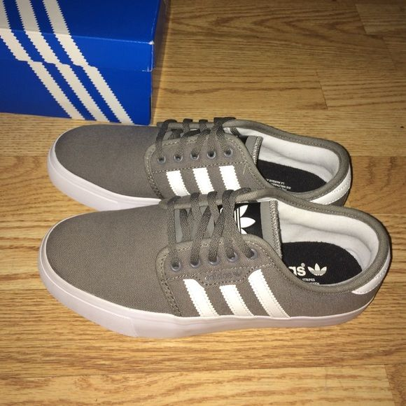 Adidas Seeley Super cute grey and white Seeleys. Size boys 5 but I'm a women's 7 and they fit perfectly. Brand new, never been worn. Also selling on merc for cheaper. Adidas Shoes Sneakers