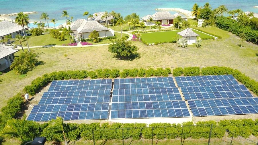 Groundmounted solar installation with palm trees