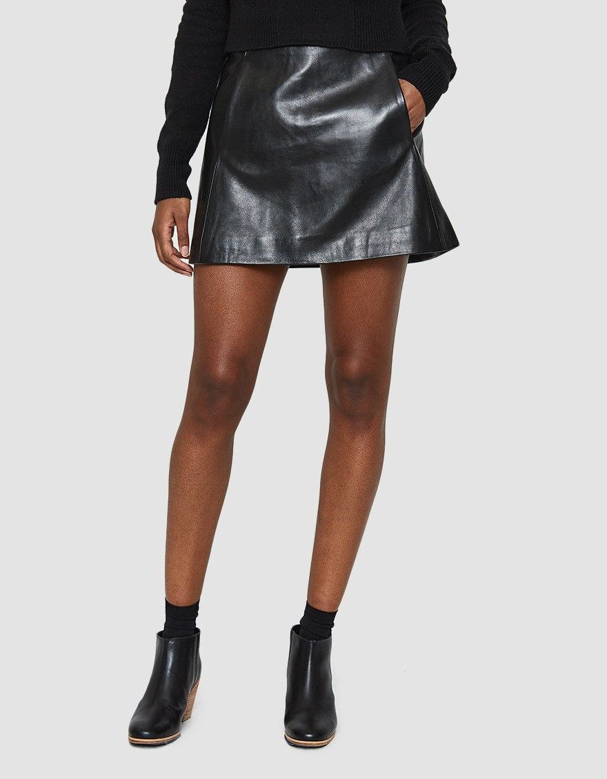 b872652c Leather mini skirt from Ganni in Black. Mid rise. Exposed back zip closure.  On-seam front pockets. Straight hem. Fully lined. Mid-thigh length.