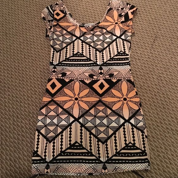 Patterned orange and black bodycon mini dress Bodycon dress from Charlotte Russe. Measures approx. 21 inches from armpit to bottom hem. Scooped in front and back. Dress is orange and white ombré color, with black patterned designs. Size medium. Charlotte Russe Dresses