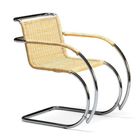 This MR Armchair was designed by Mies van Der Rohe at the Bauhaus in 1927; the wicker-work on this chair was created by Lilly Reich, assistant to Mies. Mies van der Rohe's MR chairs were designed for