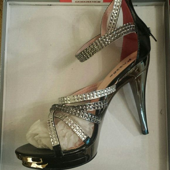 Pazzle Yassie Strappy Rhinestone High Heel Shoes New shoes in box. Never worn. Platform. Extra cushion insole. Zipper in the back. Extra taps are included. A few rhinestones are missing at the backof third strap but that defect is barely unnoticeable. Price reflects discount. Pazzle Shoes