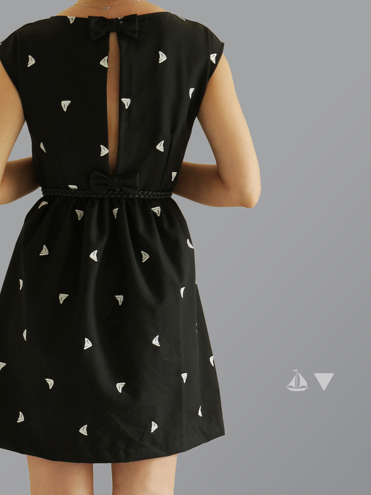 You could make a similar dress in plain black poplin and add a few random appliqued triangles or circles.
