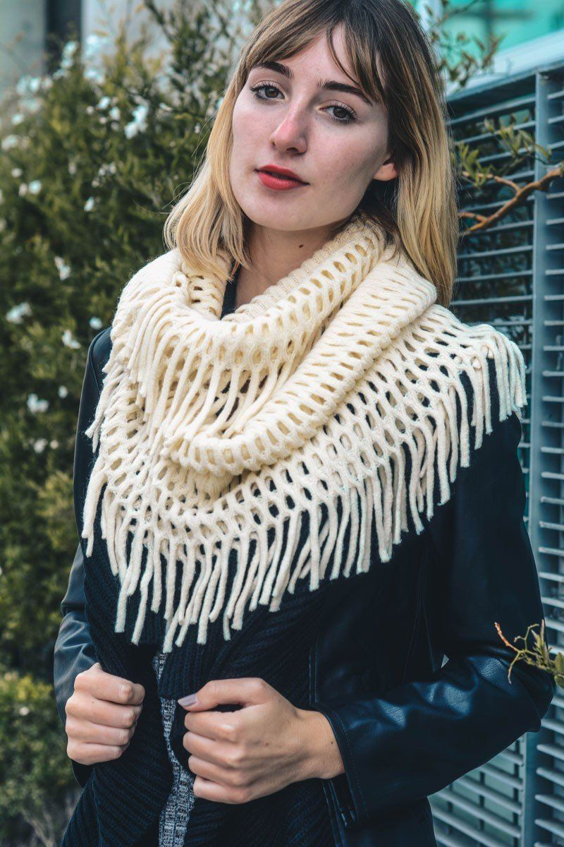 Knit infinity scarf with fringe detail. Infinity scarf