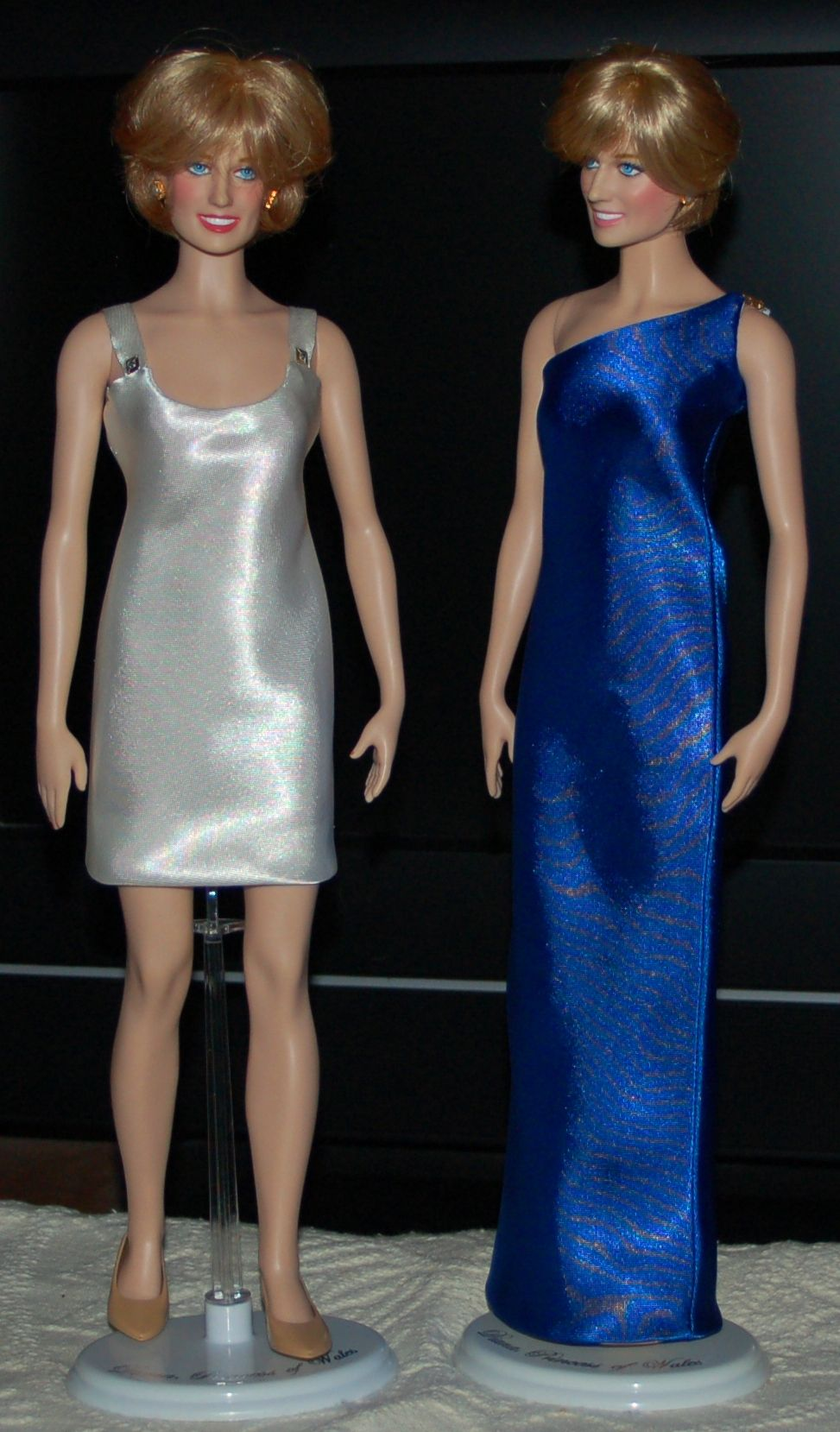 White cocktail dress and Teal Blue one shoulder gown both by Val ...