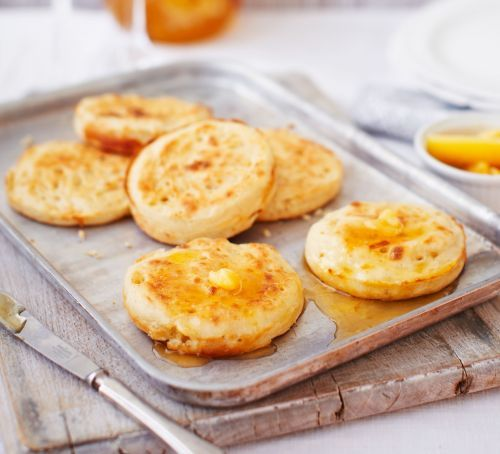 Homemade crumpets with burnt honey butter
