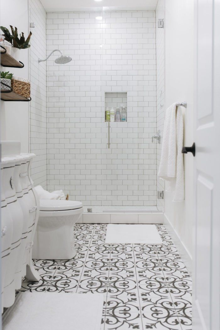 Black and white tile bathroom with a dresser turned into a vanity and a tall infinity glass shower with white subway tile, now that's a guest bathroom I want to visit! #bathroom #tile #blackandwhite #white #whitepaint #subwaytile #interiordesign