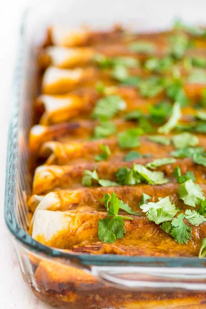 These Carnitas Enchiladas AKA Pulled Pork Enchiladas are the best enchiladas Rich crispy carnitas are wrapped in tortillas and covered with a tangy homemade enchilada sau...