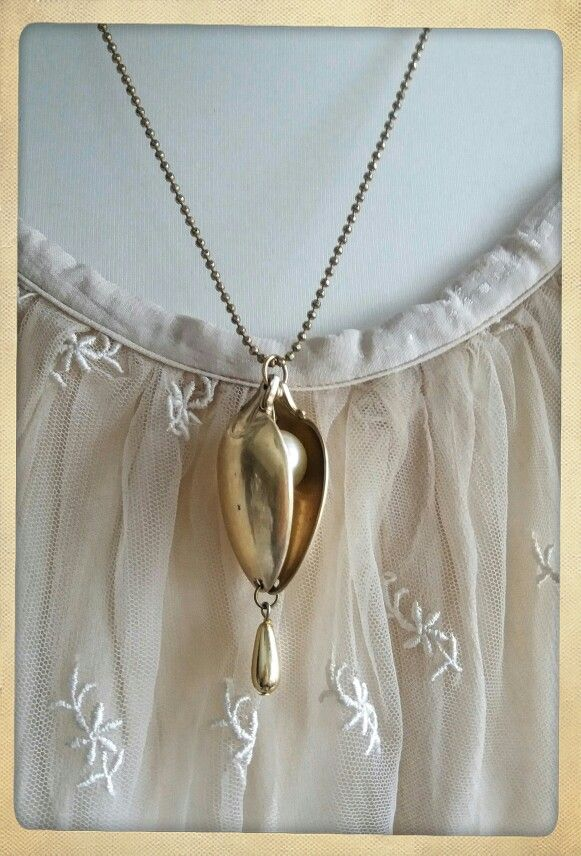 A pea in a pod-necklace. Gilt spoons. One for me, four for sale.
