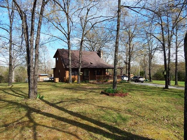 Features include a large laundry room with water softener and washer and dryer plus half bath. Other features include a master suite, several ways to heat home including central heat and air, rustic rock gas fireplace as well as a wood furnace with a 300 gallon water tank for endless hot water and 2 years worth of wood for the furnace that was just delivered. Wood heat not your thing? Then switch from wood to gas with just a flip of a switch. The 12 1/2 acres have several walking trails, wet…