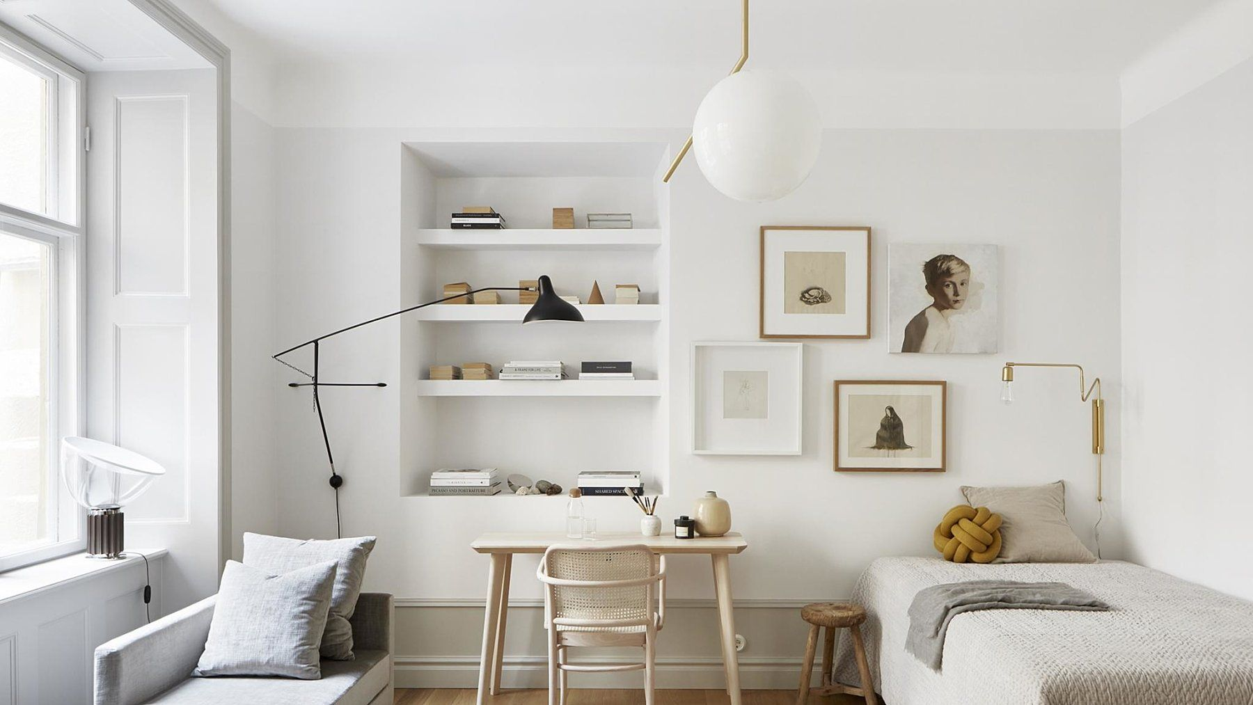 Photo of In the ceiling, the beautiful lamp IC S2 hangs in brass from Flos, in …
