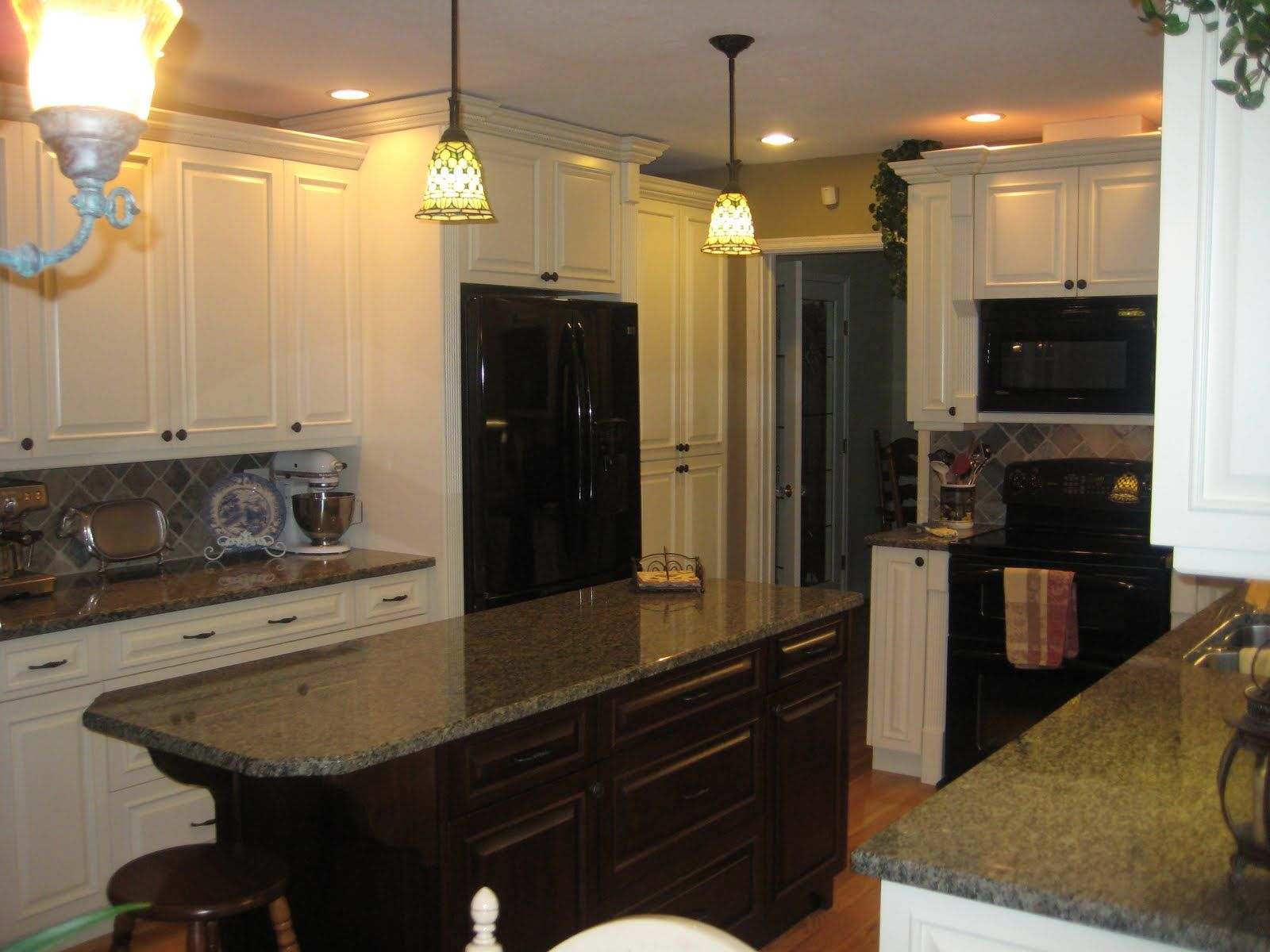 Dark Island White Cabinets Contrast Between The White Actual Black Countertops Kitchen Countertops Granite Colors Kitchen Cabinets With Black Appliances
