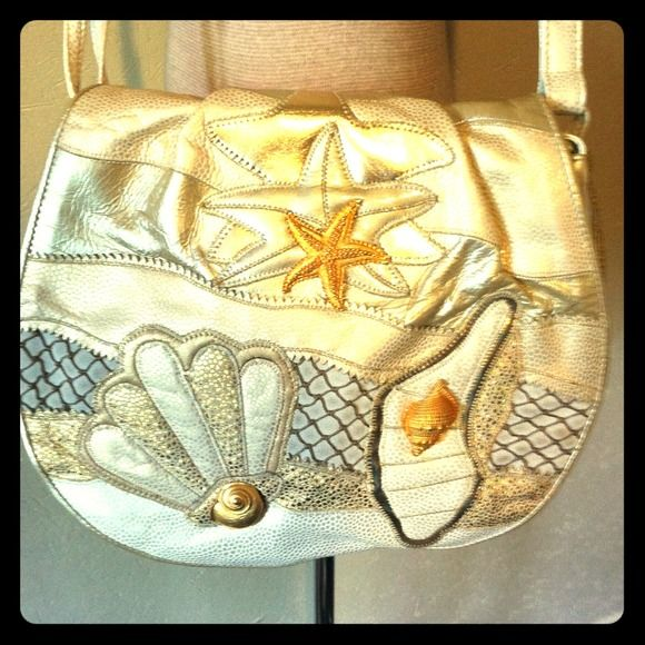 VINTAGE Sharif Leather Beach Themed Bag Purse A quality crafted vintage circa 1980s bag by Sharif, made in USA. This large shoulder bag is done in white, gold, and pearlized leather with leather patchwork starfish and shells and gold jewel accents, back is leather made to look like iradescent pearls. Front flap snaps and interior spacious with 2 large compartments and zip up pocket. Purse is pristine! Sharif Bags