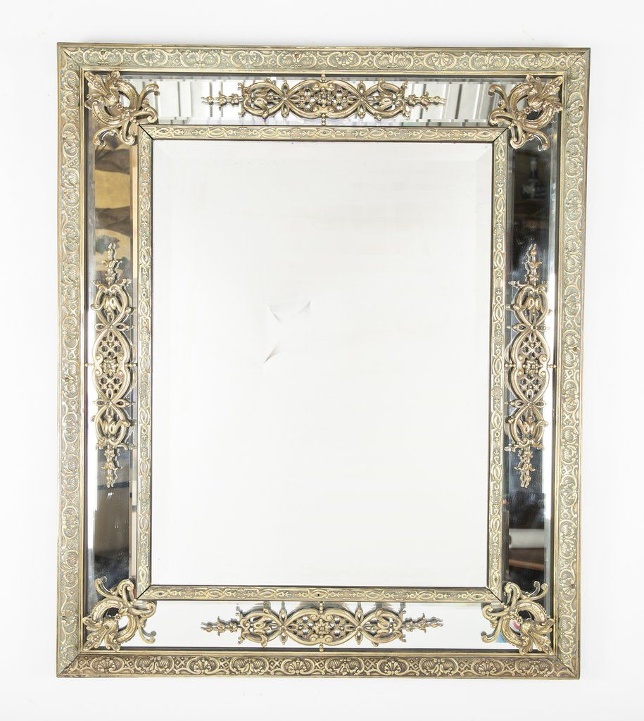 A handsome Continental beveled mirror set in a mirrored frame with ...