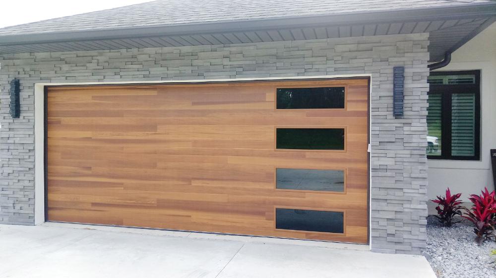 Beautiful Cedar Plank Garage Door With Tinted Glass In 2020 Garage Doors Wood Garage Doors House Gate Design