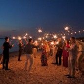 Wedding lighting for after a beach wedding and reception! Sparklers add some magic to your event on the beach! Then send them back to their rooms with Glow sticks for thank yous for some more private evening fun!