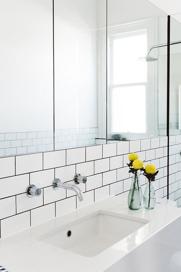 Dark Grout Subway Title And Flush Mount Mirrors In