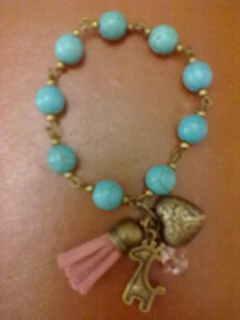 863335ea0538 pulsera bolitas azul turqueza y borla rosa