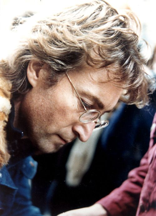Lennon.... This is a picture of Lennon signing the album of the man who would kill him hours later. chilling at the least...