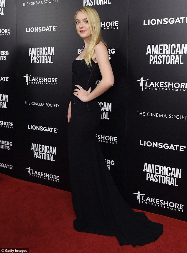 Showstopper! The I Am Sam actress stunned in a skintight black gown with long, flowing tra...