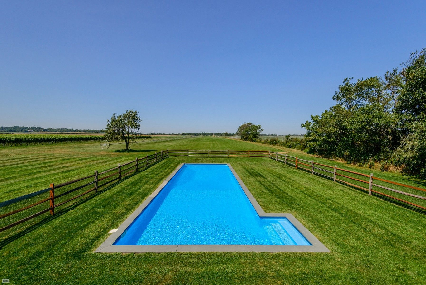Cutchogue – This rare waterfront estate comprises a classic farmstead with 1860s farmhouse, two-story barn with modern poolhouse, pool and detached art/exercise studio, along with 32 acres of preserved farmland, including a 5+ acre vineyard. Also included are three separate buildable parcels overlooking Long Island Sound, two waterfront and one...