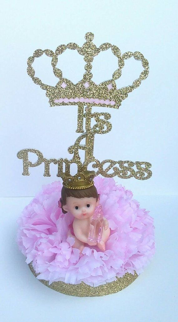 These gorgeous centerpieces are perfect for welcoming your little Princess!  »Each centerpiece is approximately 8 inches high and about 6 inches wide (with sign and figurine) «  »This listing is for 1 royal centerpieces. Each will include: a pink flower base (as seen in photo), a baby girl figurine and a Its A Princess sign  **The Its A Princess sign will be packed separately to avoid damage during shipping.  »» Assembly «« The base is Styrofoam and can easily be penetrated by the sign. Figur...