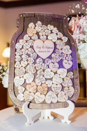 Wedding guest book frame with wooden hearts