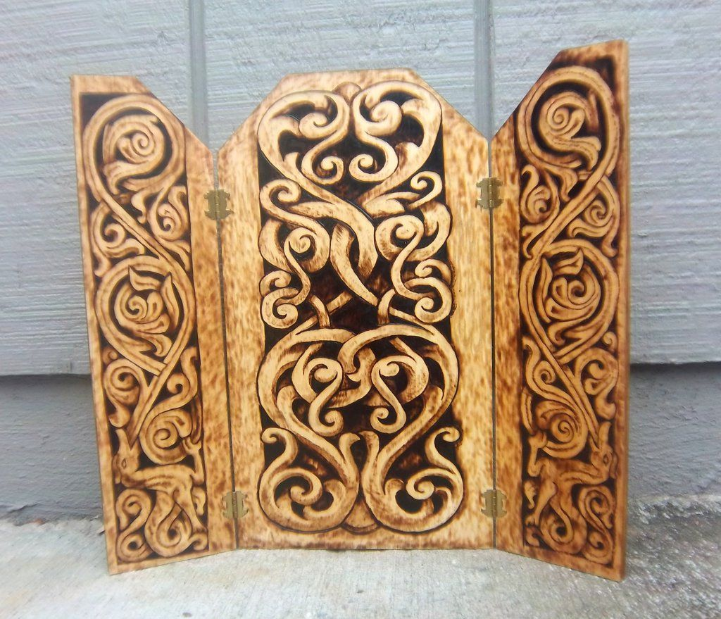 Stave designs Triptych Wood-burned by runehammer9.deviantart.com. This wooden triptych is hand-burned with two designs featured on two stave churches, in particular Gol, Hallingdal, Norway and Heddal Stave Church in Notodden, Norway. These designs, although carved and displayed on christian buildings of worship, feature traditional nordic/scandinavian-style carving that date before the conversion period. This piece would be a great background piece for an altar, or a display.