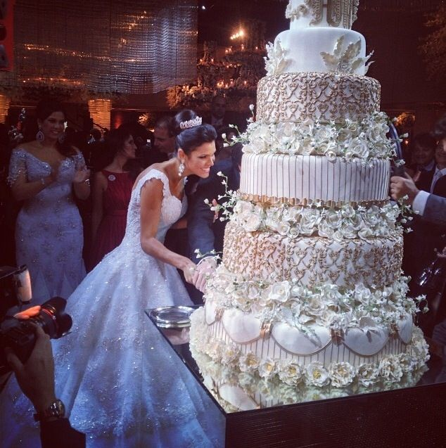 Indian Weddings Inspirations White Wedding Cake Repinned By Indianweddingsmag Indianweddingsmag Com Fake Wedding Cakes Wedding Cake Photos Wedding Cake Art