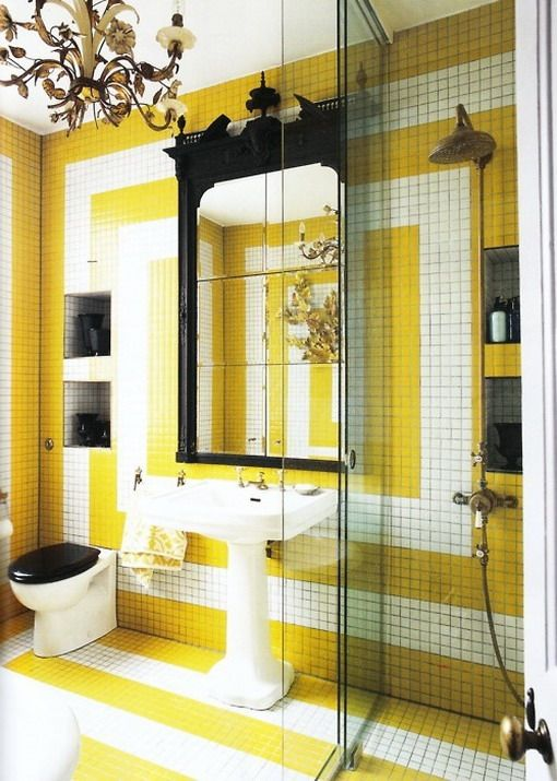 this makes me want to paint yellow + white stripes on my bathroom ...