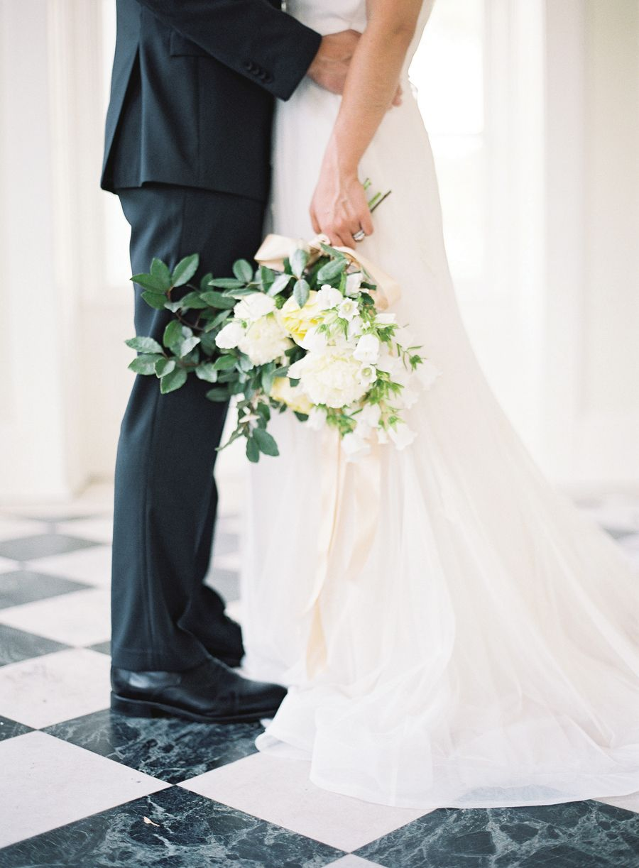 Graceful white bouquet by Fern Studio Floral & Event Design, dress by Chaviano Couture, image by Landon Jacob. See more in the Winter 2014 issue of Weddings Unveiled: www.weddingsunveiledmagazine.com.