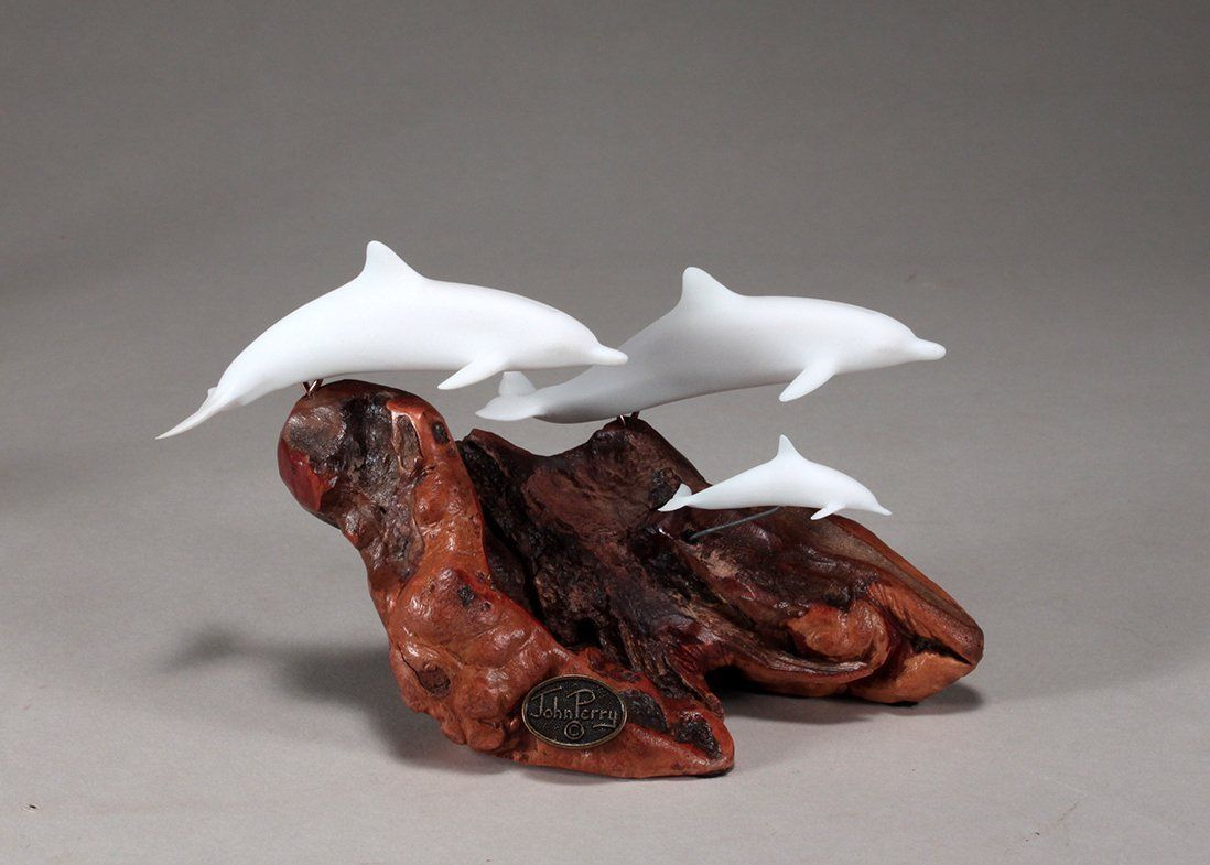 Dolphin family sculpture by john perry pellucida on burl