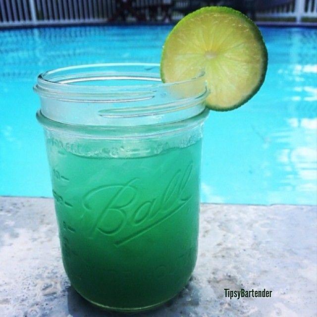 MERMAID WATER 2 parts Captain Morgan Spiced Rum Splash Malibu Coconut Rum 2 parts Pineapple Juice Splash Blue Curacao Squeeze Lime Juice