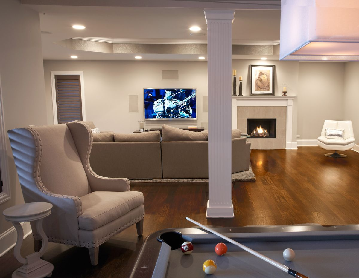 Many Rec Room Spaces Receive A Notoriously Masculine Design With Heavy Leather Chairs And Dark Curtains But T Rec Room Recreational Room Home Theater Seating