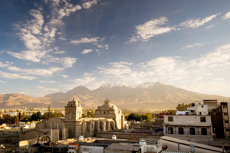 Dawn at Arequipa, showing their Spanish-style church backed by snow-topped (active!) volcanoes.