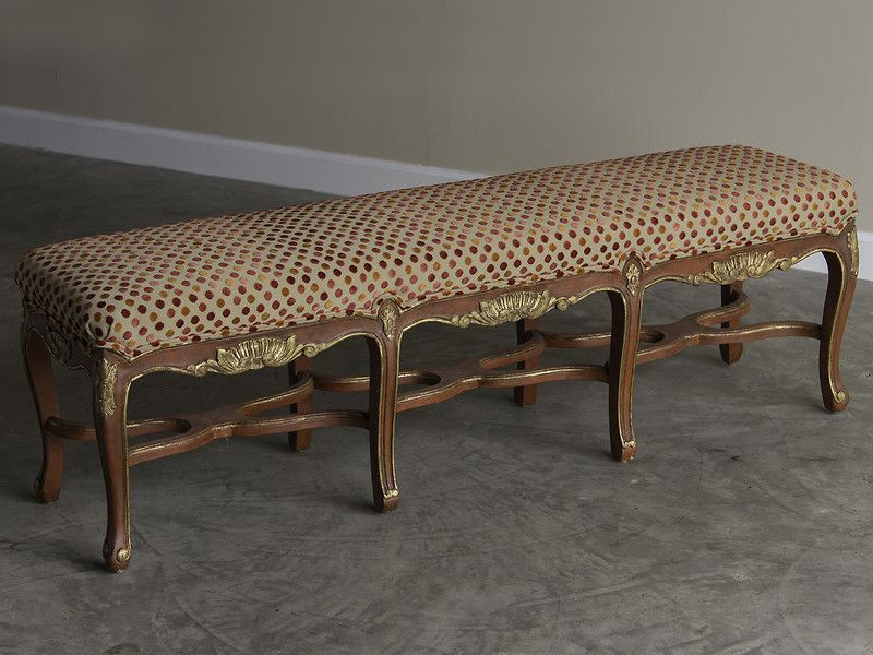 Regence Style Painted Bench, Eight Cabriole Legs with Stretchers, Upholstered Seat, France. This attractive bench features the beautiful cabriole legs joined by stretchers that appeared during the early eighteenth century when Louis XV was too young to assume the throne of France and his mother and uncle ruled in his stead as Regents of France. The details to notice here on this bench include the four legs at the corners face outward at a forty-five degree angle while the inner two legs on…