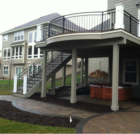 A Second Story Deck Designed With Curved Rail, Straight Stringer Staircase  And Patio Below Creates A Versatile And Attractive Outdoor Space, Notice  The Hot ...